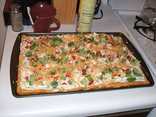 veggie pizza on cookie sheet
